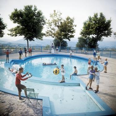 "1977 Summer Camp The swimming pool of ""St Sat"".  1977 Les grandes vacances La piscine de St Sat.  Bernard Faucon / Agence VU"