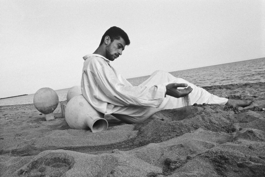 """Iran, Bandar Lenghe, February 1999 - Omid (his name means """"Hope"""" is a teacher, he is also a musician and plays """"Kuzeh""""; before women use to go and take water with it."""
