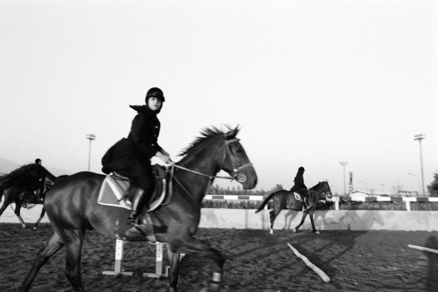 Iran, Tehran, July 2000 - Azmoun equestrian center, Horse riding for girls.
