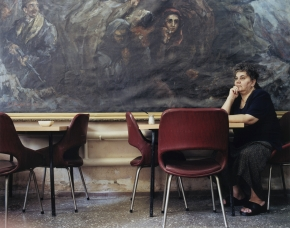 © RIP HOPKINS / AGENCE VUHOME AND AWAYOUZBEKISTAN, 200229/07/02Alexandra Baclanova in Tashkent's Greek Community Centre with a painting depicting communists during the Greek civil war. She is 52 years old. She is Greek and works as the Centre's care taker. Her parents came here in 1949 following the communists' defeat in the Greek civil war. She wants to leave for Greece, but no longer has contact with her family there.N°10650