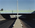 © RIP HOPKINS / AGENCE VUHOME AND AWAYOUZBEKISTAN, 200202/08/02Road in Tashkent's town centre leading to Uzbekistan's President Islam Abduganiyevich Karimov's private residence. The inscription on the bridge reads : The next generation will receive this land.N°10650
