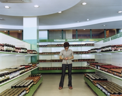 © RIP HOPKINS / AGENCE VUHOME AND AWAYOUZBEKISTAN, 200203/08/02Lena Olegovna in Tashkent's Gifts of Mother Nature wine shop owned by President Karimov's eldest daughter, Lola Karimova. Lena is 24 years old. She is a Russian and English translator. Her mother is half Russian, half Tatar and her father is half Russian, half Uzbek. She wants to leave for Norway.N°10650