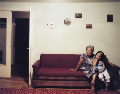 © RIP HOPKINS / AGENCE VUHOME AND AWAYOUZBEKISTAN, 200204/08/02Anastasya Ni is 2 years old sitting with her great grandmother Elestaveta Kan who is 77 years old, in the family flat in Tashkent. Elestaveta Kan was sent to Uzbekistan with her Korean parents from the Russian / Chinese border by Stalin in 1937. She does not want to leave.N°10650