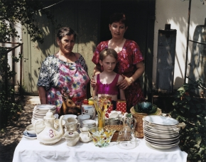 © RIP HOPKINS / AGENCE VUHOME AND AWAYOUZBEKISTAN, 200207/08/02Lisa Maliyavini with her granddaughter Lisa Maliyavini and her daughter Olga Maliyavini selling their possessions in front of their house in Gazalkent, 60 kilometres north of Tashkent.Lisa Maliyavini is 76 years old. She is a retired accountant. She was sent here from the Russian Volga region by Stalin in 1939. Lisa Maliyavini is 10 years old. She is a school girl.Olga Maliyavini is 42 years old. She was an officer in the Soviet KGB, she is now an Uzbek army sergeant. Her father was also Russian, sent here by Stalin in 1937.They have left for Novgorod in Russia.N°10650
