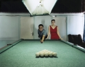 © RIP HOPKINS / AGENCE VUHOME AND AWAYOUZBEKISTAN, 200217/08/02Wu Janliang and Tanya Poleva in Tashkent's Billiard Klub.Wu Janliang is 55 years old. He is the director of a language institute in Peking, China.Tanya Poleva is 22 years old. She studies at Tashkent's Oriental Language Institute. All her grandparents are Russian and were born here. She does not want to leave.N°10650