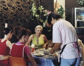 © RIP HOPKINS / AGENCE VU HOME AND AWAY OUZBEKISTAN, 2002  18/08/02 Irina Zolotareva and Anastasiya Zolotareva with Nadejda Vodotievskaya and Diana Vodotievskaya in Tashkent's Korean Zolotoe Runo restaurant. Irina Zolotareva is 41 years old. She is a hairdresser. Her parents came from Russia. She wants to go to Moscow with Anastasiya, her 5 year old daughter. Nadajda Vodotievskaya is 48 years old. She is a hairdresser. Her grandparents came from Russia during the 1930's. She and Diana, her 12 year old daughter, do not want to leave.  N°10650