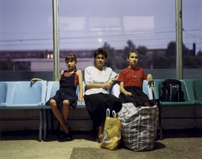 © RIP HOPKINS / AGENCE VU HOME AND AWAY OUZBEKISTAN, 2002  25/08/02 Guzel Fazalova with Raylon Moisseeva and her daughter Olga Moisseeva waiting in Tashkent's North Station. Guzel Fazalova is seeing off her friend Olga Moisseeva who is leaving Uzbekistan definitively on the eight o'clock evening train to Moscow. Guzel Fazalova is 13 years. She is a school girl. Here parents were sent here from Tatarstan. She will leave for Tatarstan with her family as soon as her brother finishes his military service. Raylon Moisseeva is 33 years old. She is a cook. Her mother is Uzbek and her father is Tatar. She will leave for Tatarstan in three months to join her daughter and husband. Olga Moisseeva is 13 years old. She is a school girl. Her father's grandparents were sent her from Russia in 1933. She has left for Moscow, Russia.   N°10650