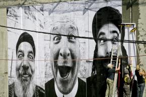 """Israel, Jerusalem, 7 March 200728 Millimetres, Face 2 Face.Pasting on the Separation wall. Security Fence, Israeli side, Adu Dis.""""Holy Triptich"""": Cheikh Aziz, Brother Jack and Reb Eliyahu.Israël, Jérusalem, 7 mars 200728 Millimetres, Face 2 Face.Installation sur le mur de séparation. Barrière de sécurité, côté israélien, Adu Dis.""""Triptyque sacré"""": Cheikh Aziz, Frère Jack et le Rabbin Eliyahu.JR"""