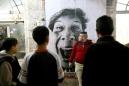 Palestine, Ramallah, March 200728 Millimetres, Face 2 Face. Pasting in Ramallah.Portraits of sculptors: Drora from Kfar Sava, Israel.Palestine, Ramallah, Mars 200728 Millimetres, Face 2 Face. Installation à Ramallah.Portraits de sculpteurs: Drora de Kfar Sava, Israël.JR