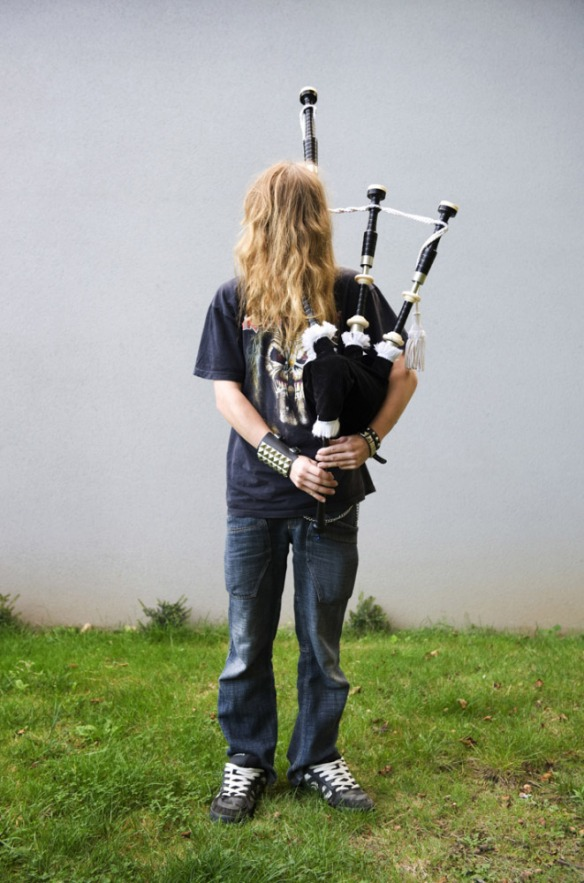 France,  01 October 2009 - What would be a faceless world ? Young man playing bagpipes.