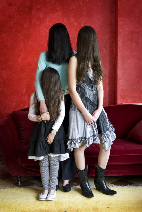 France,  17 April 2009 - What would be a faceless world ? Woman with her two daughters.