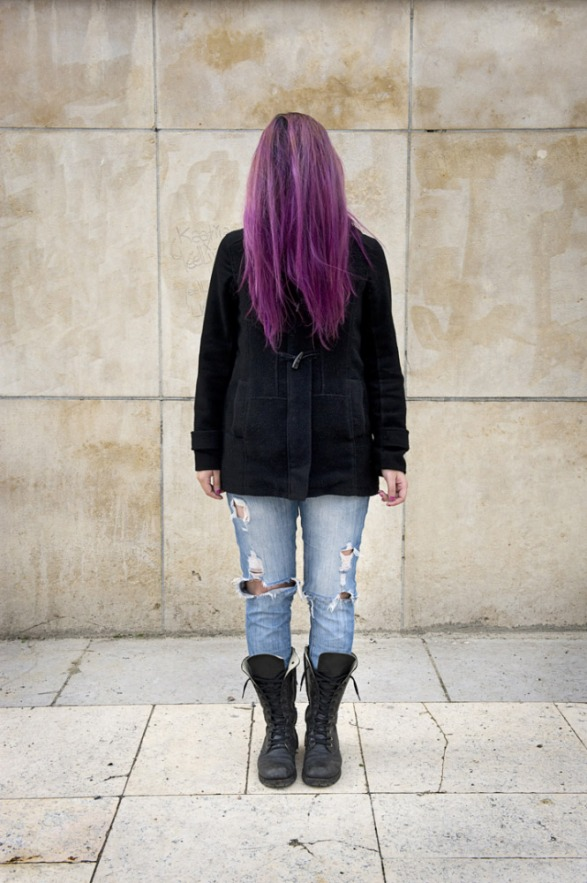 France, 07 March 2013 - What would be a faceless world ? Purple-haired woman with teared up pants.