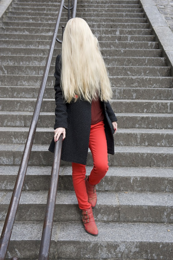 France, 06 March 2013 - What would be a faceless world ? Blond woman with red pants.