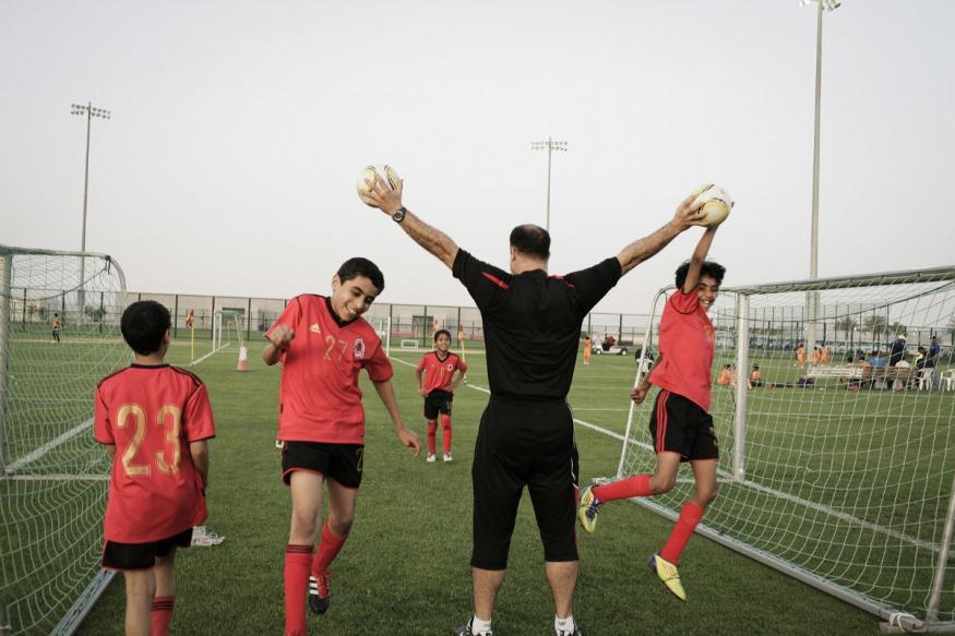 Qatar, Al Rayyan, 14 April 2012 - Al-Rayyan Qatari soccer club.The National Juniors (7-12 years old) competition takes place on the 12 soccer fileds. Al Rayyan soccer team.