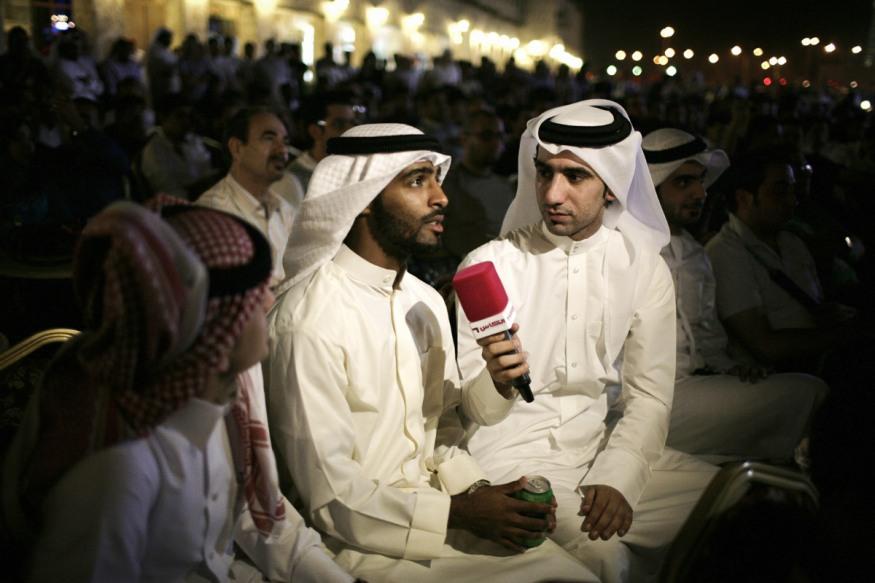 Qatar, Doha, 21 April 2012 - FC Barcelone-Real match in Waqif Souk.A journalist of TV Al Kass.