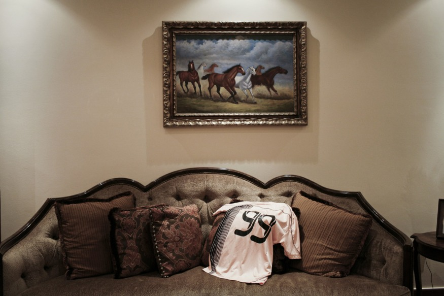 Qatar, Doha, 23 April 2012 - Mariam's shirt on the couch in her father's home.Mariam is a soccer player for Al Sadd soccer team.