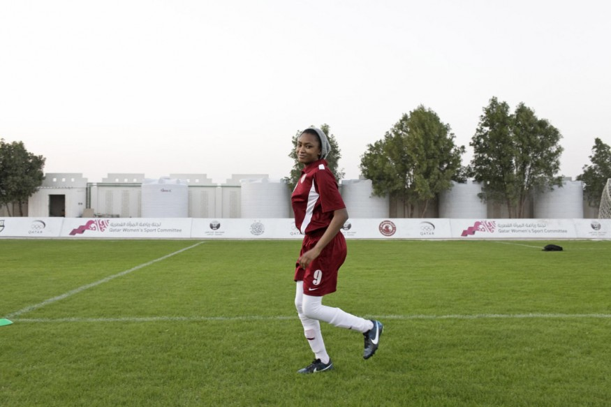 Qatar, Doha, 23 February 2014 - Dina, from the Junior National team (less than 14 years old), is training on the sports ground of Omar Bin Khatab Boys school.