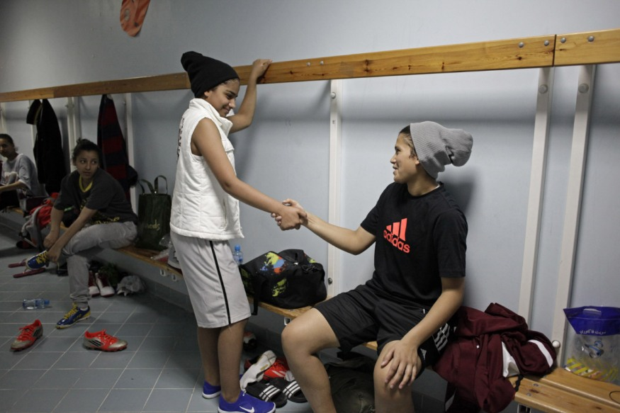 Qatar, Doha, 01 March 2014 - In the changing room, Asma 15 years old and Khadar, 15 years old (nicknammed Latifa). This afternoon, less 14 years old players will play a friendly game against the 12 years old boys from Aspire.