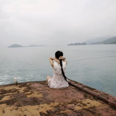 Vietnam, Ha Long bay, 29 April 2015Woman on a boatVietnam, baie de Ha Long, 29 avril 2015femme sur un bateauFranck Ferville / Agence VU