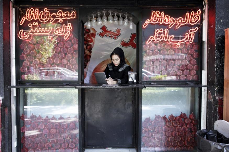Iran, Isfahan, 06 November 2013 - Pomegrate juice shop.