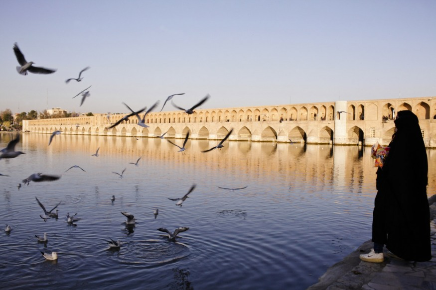 Iran, Isfahan, 08 December 2014 - The Si o se pol Bridge with its thirty-three arks by the river Zayanderoud, flowing again in the heart of the city, after being dry for so many months. Even the birds came back.
