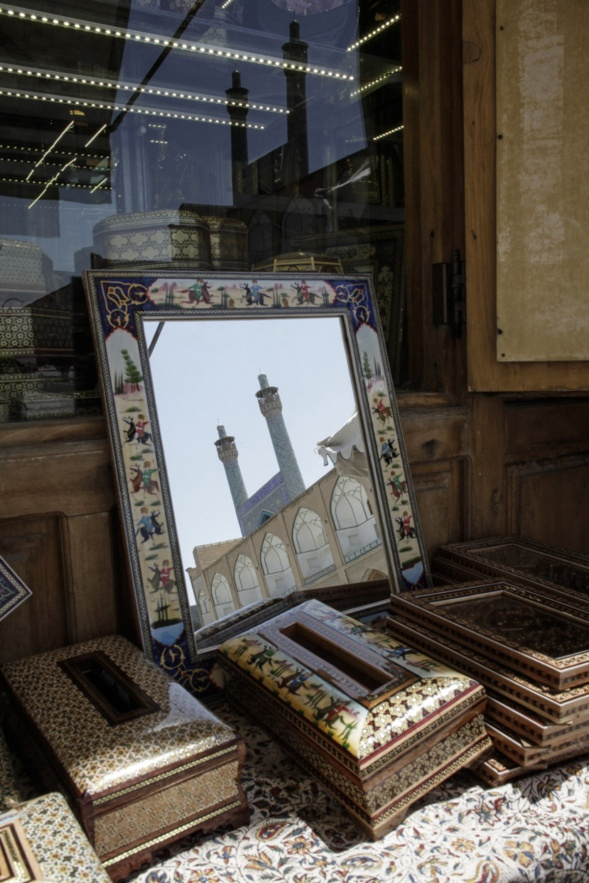 Iran, Isfahan, August 2015 - Naghsh-e Jahan Square or Emam Square. In the mirror, the Emam mosque.